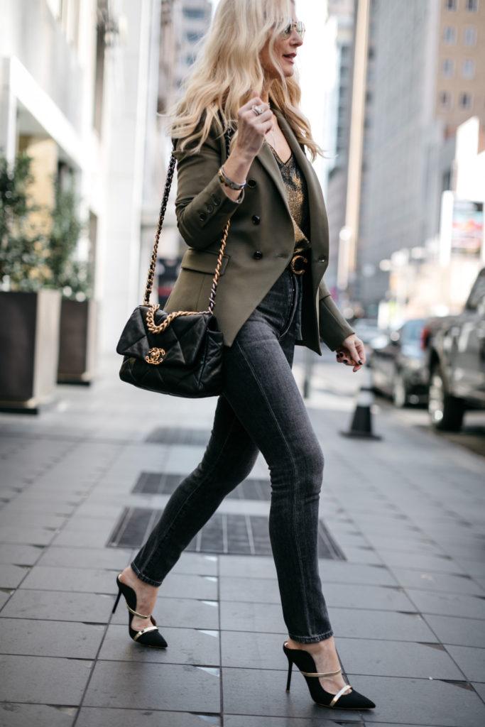 Fashion blogger wearing black heels and a black handbag