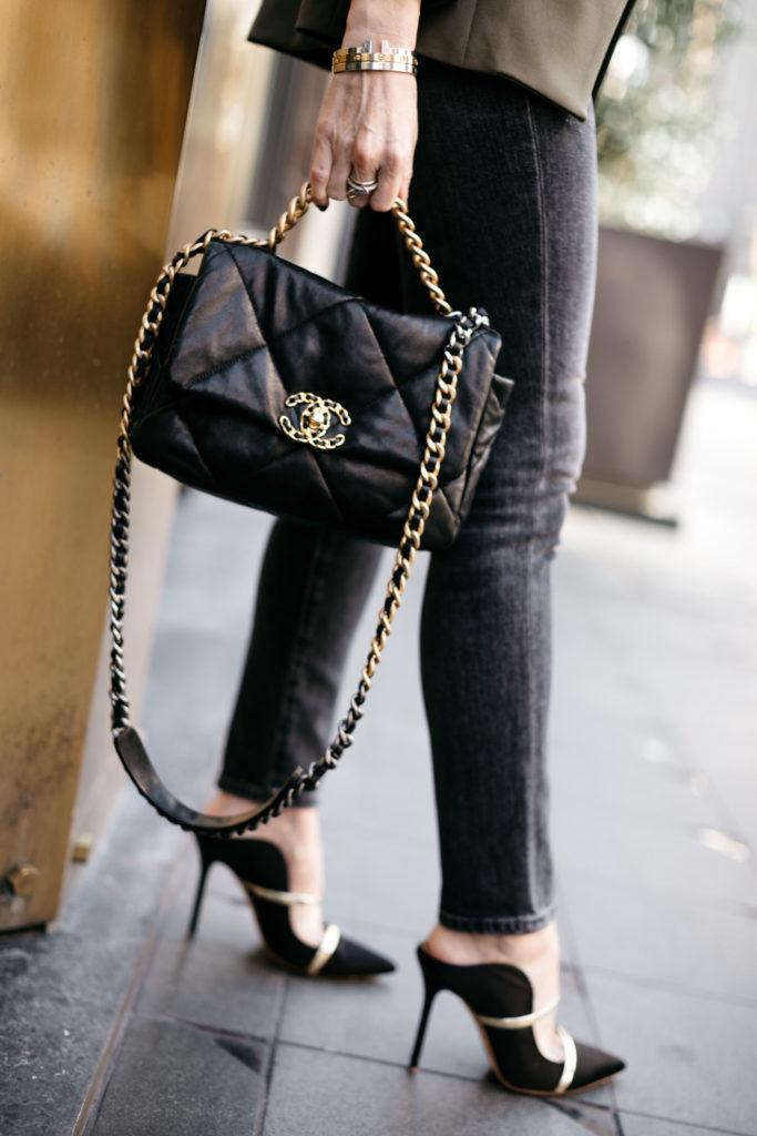 Fashion blogger carrying a black Chanel handbag