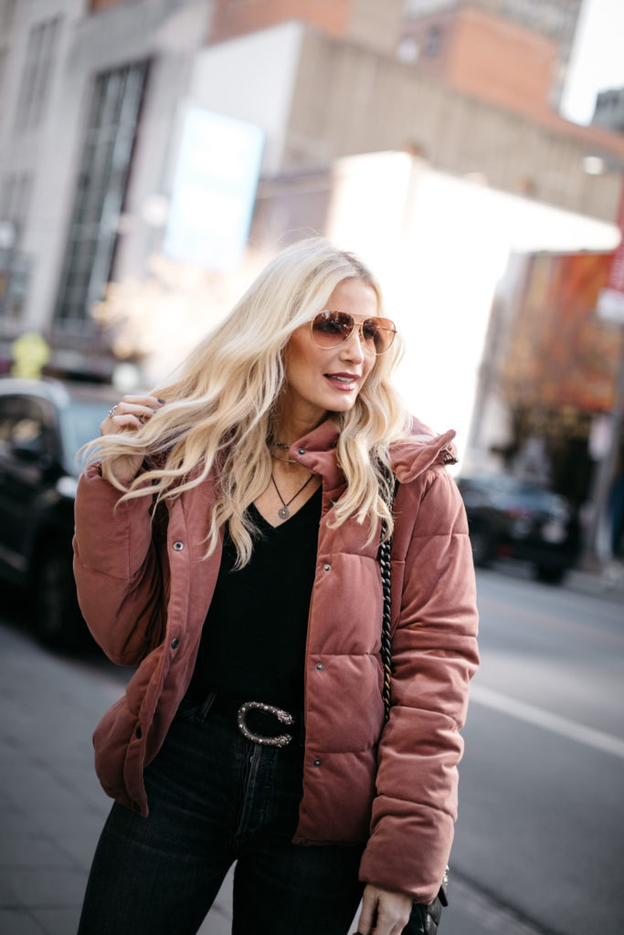 Fashion blogger wearing a winter jacket and a Gucci belt