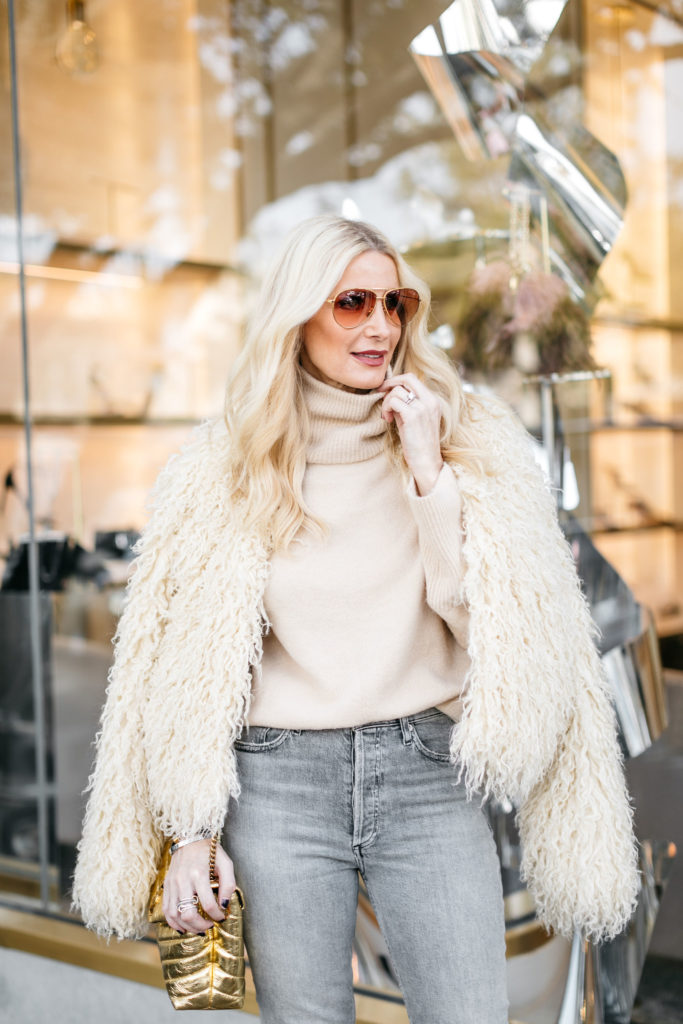 Dallas blogger wearing a faux fur jacket and a sweater