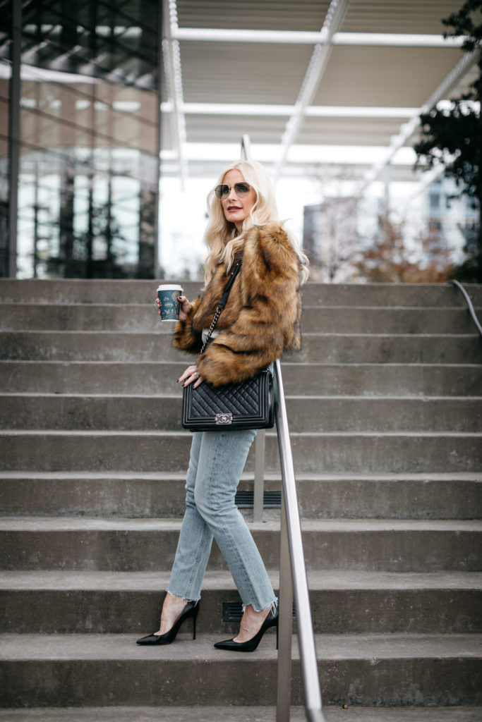Dallas blogger wearing a Topshop faux fur jacket and Agolde jeans