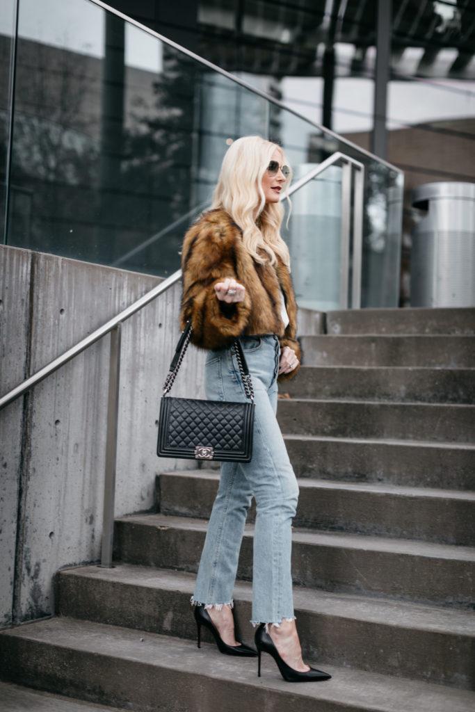 Dallas blogger carrying a Chanel Boy Bag