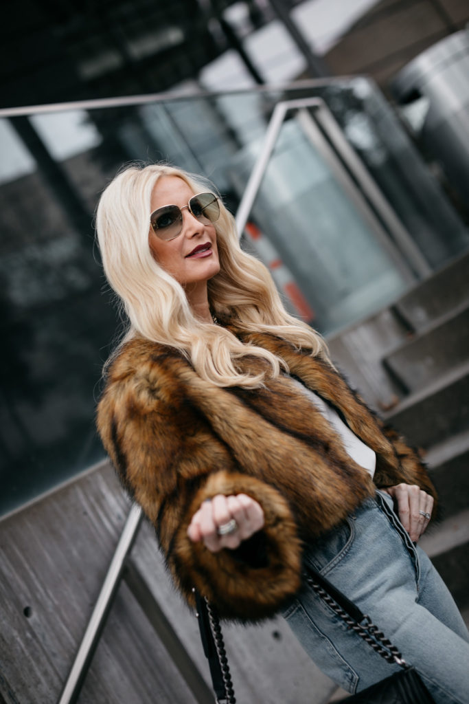 Dallas influencer wearing a faux fur jacket and Gucci sunglasses