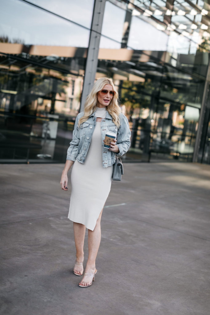 Dallas blogger wearing a denim jacket and a dress