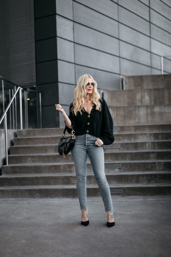 Dallas influencer wearing a black cardigan and a black Dior saddlebag