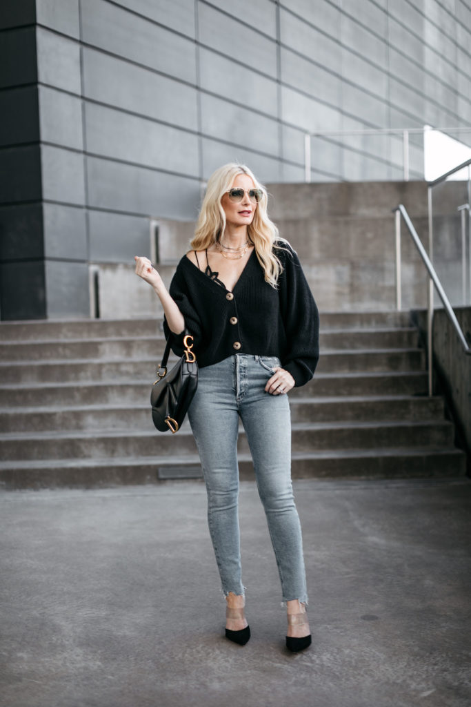 Dallas blogger wearing a black cardigan and a Dior handbag