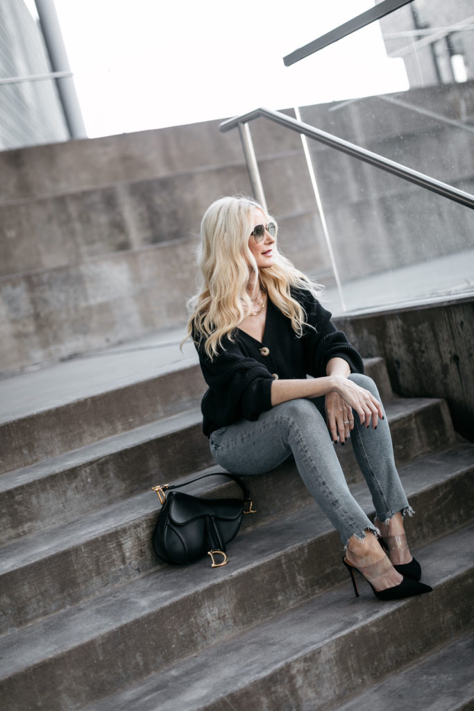 Fashion blogger wearing jeans and a black cardigan