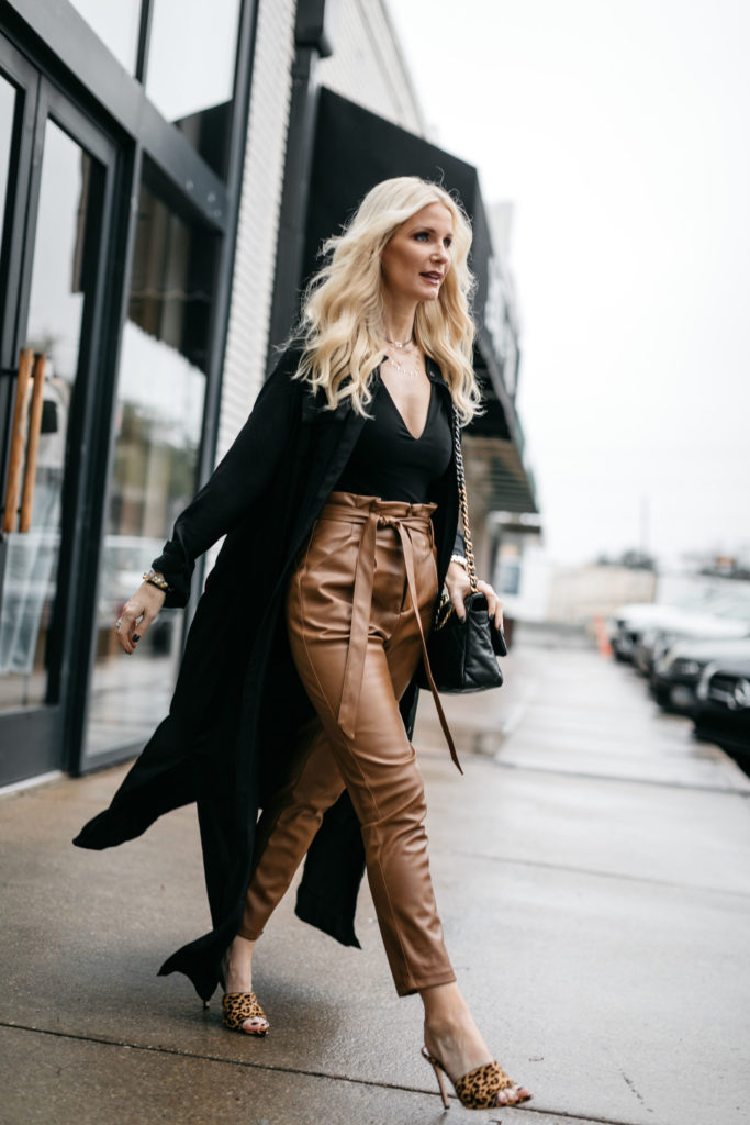 Dallas woman wearing faux leather pants