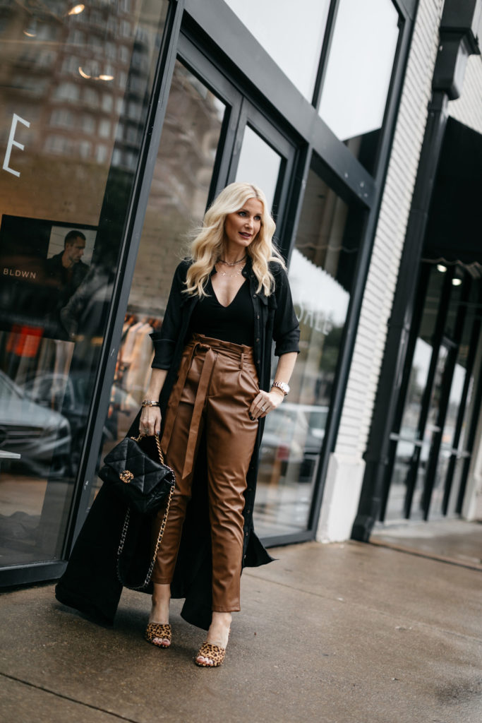 Dallas blogger wearing faux leather pants and a Chanel 19 bag