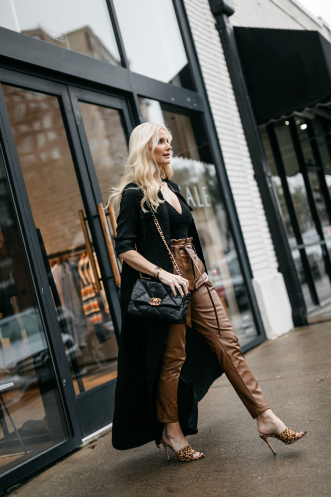 Dallas influencer wearing faux leather pants and leopard heels