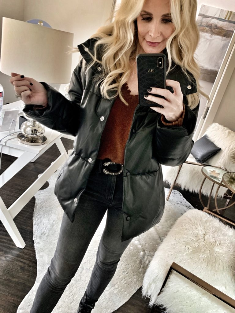 Style blogger wearing a black jacket with black denim