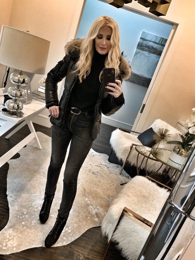 Dallas blogger wearing a fur hooded jacket with jeans