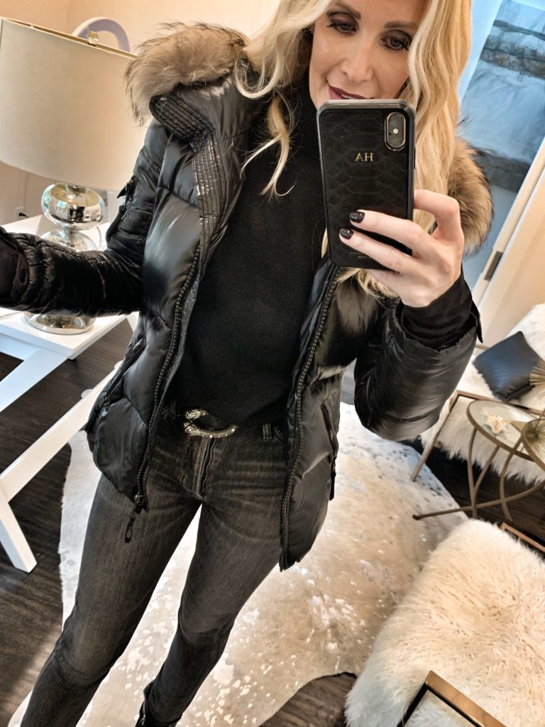 Fashion blogger wearing a faux leather puffer