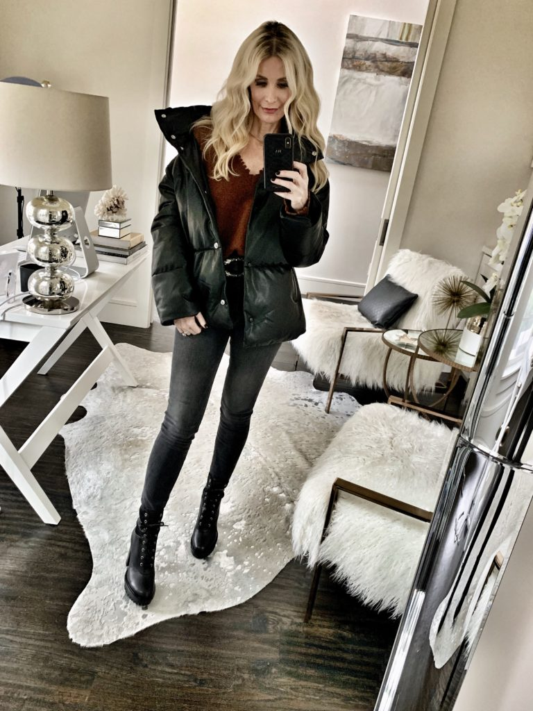 Dallas style blogger wearing a puffer jacket with jeans