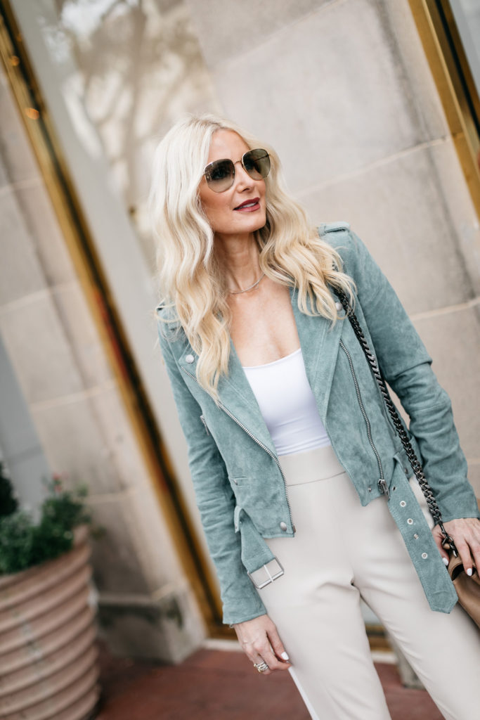 Dallas blogger wearing a moto jacket and a jumpsuit