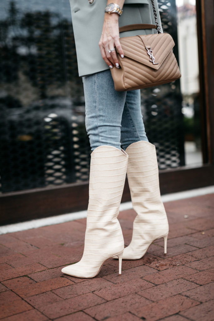 Dallas fashion blogger wearing knee high boots and jeans