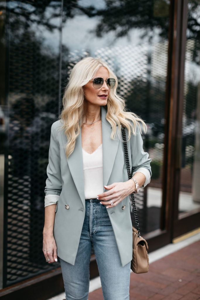 Fashion blogger wearing a white camisole and an oversized blazer