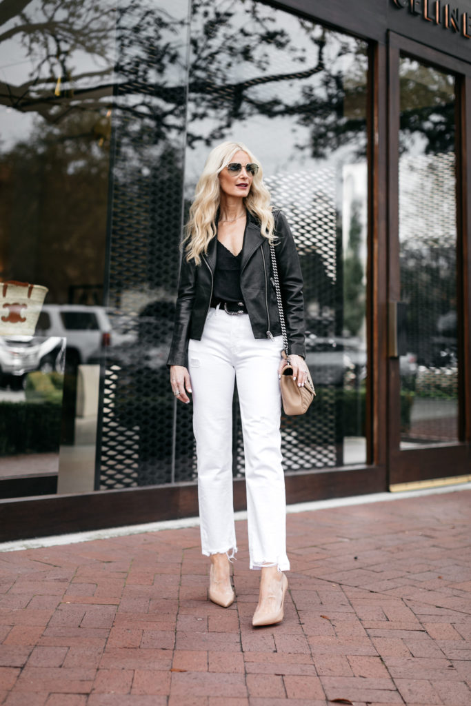 Dallas blogger wearing a black leather jacket and white jeans