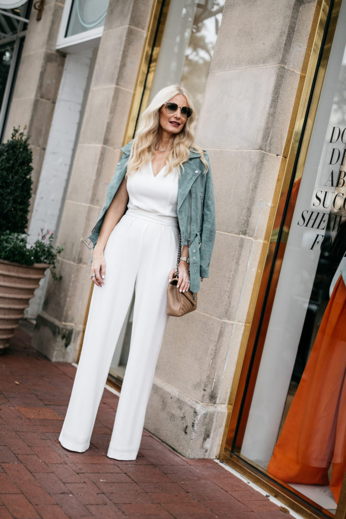 Dallas blogger wearing a white jumpsuit
