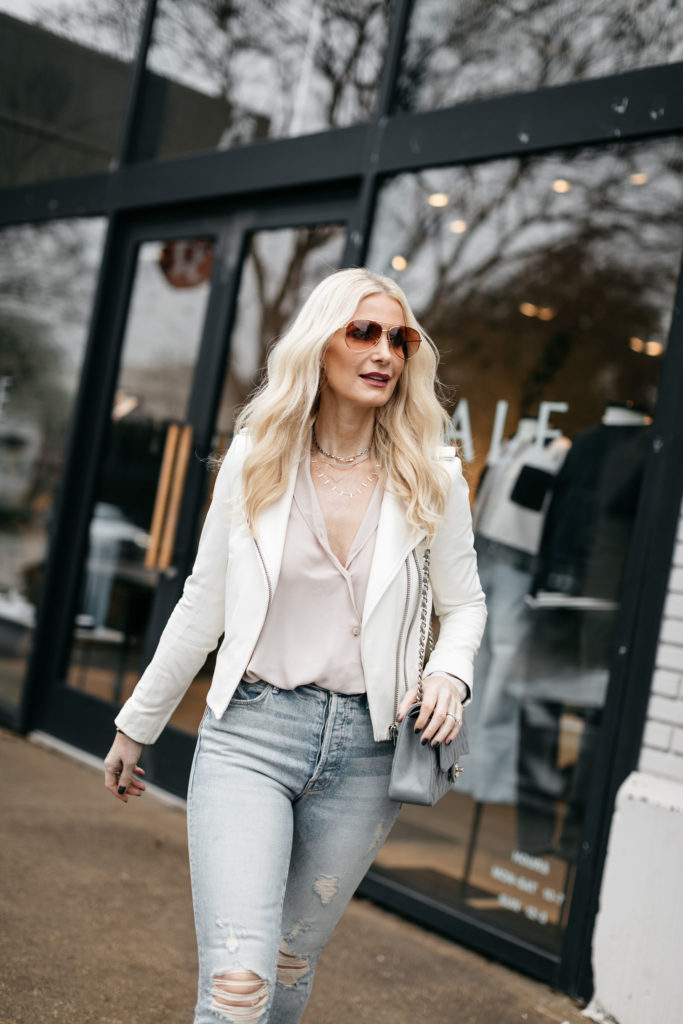 Dallas blogger wearing a white leather jacket