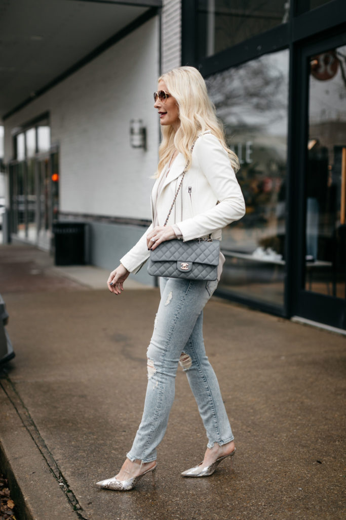 Dallas influencer wearing ripped jeans and carrying a Chanel Flap bag