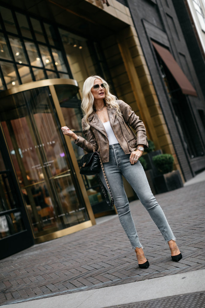 Fashion blogger wearing a moto jacket and jeans