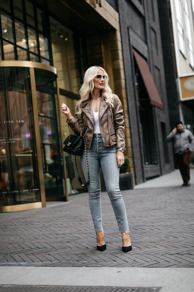 Dallas fashion blogger wearing a white bodysuit and jeans