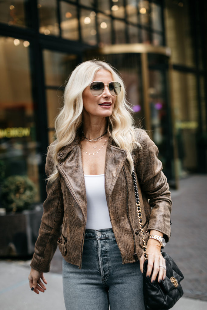Dallas style blogger wearing a moto jacket and Gucci sunglasses