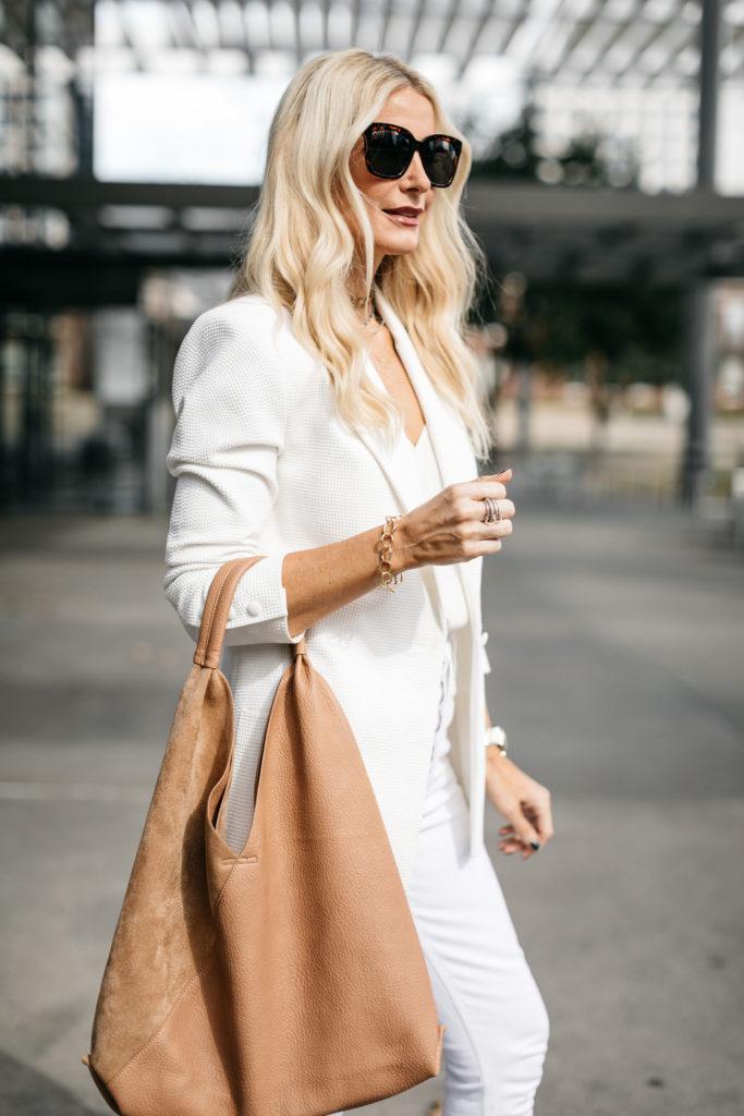 Dallas blogger carrying a tan bag