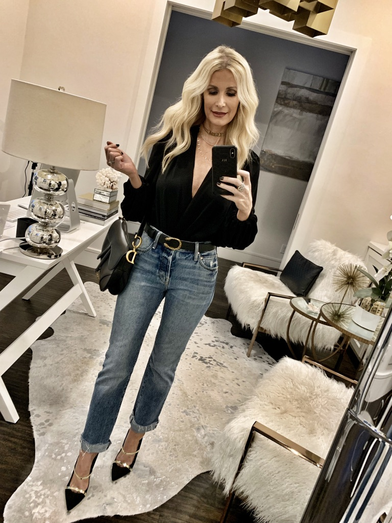 Dallas blogger wearing a black blouse and denim