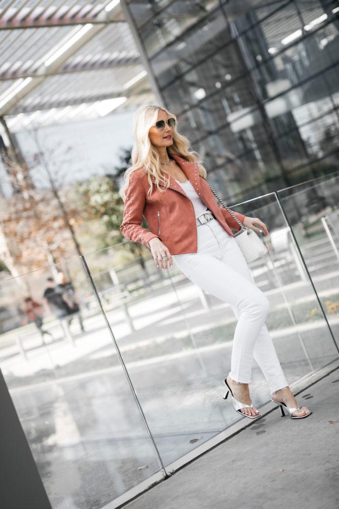 Dallas blogger wearing a pink moto jacket