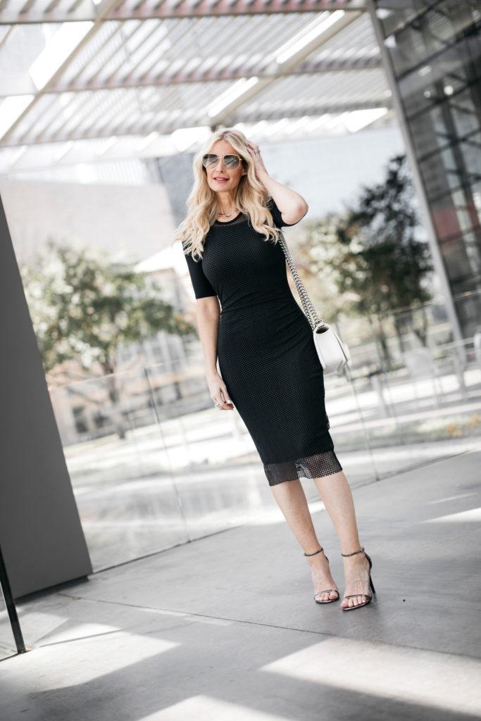 Dallas blogger wearing a black midi dress and black heels