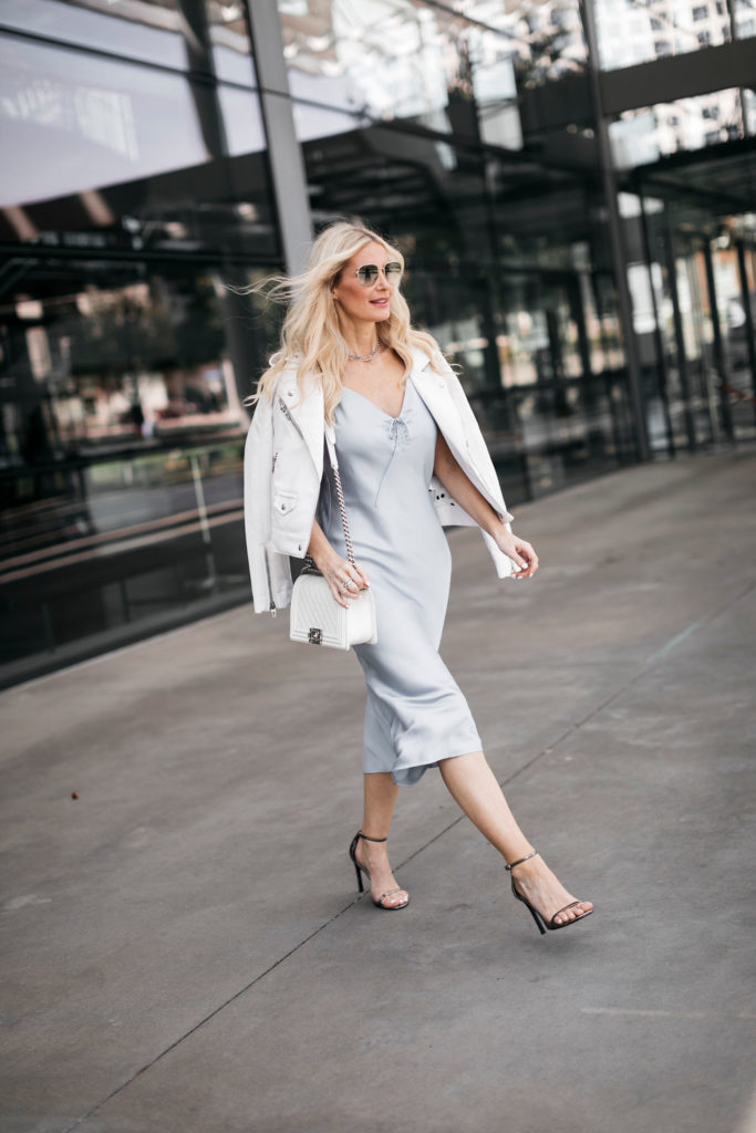 Dallas influencer wearing a midi dress and heels