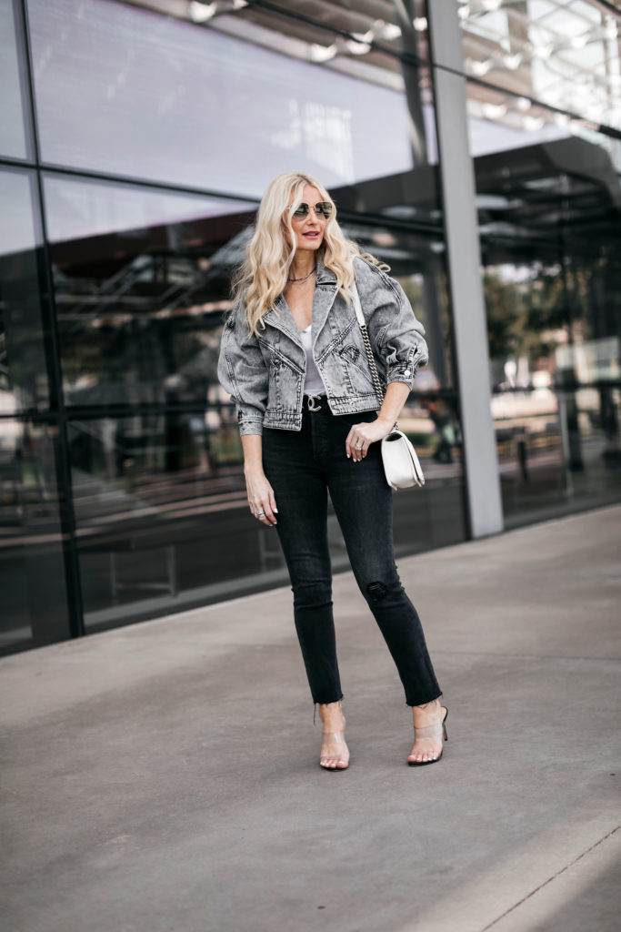 Dallas blogger wearing a grey denim jacket and black jeans