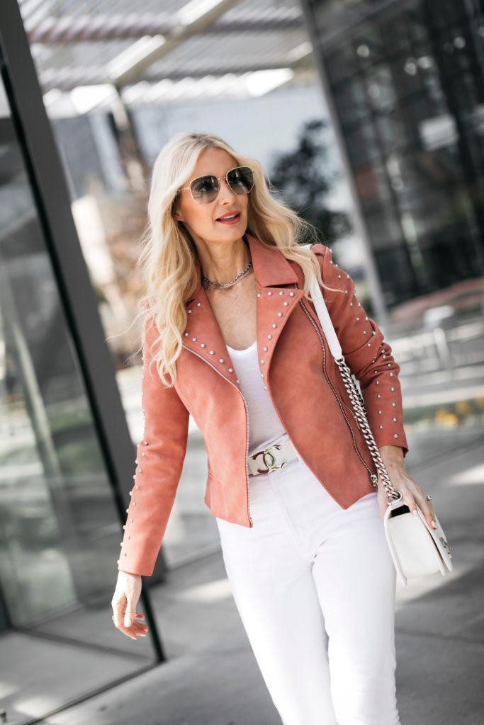 Dallas blogger wearing a pink studded moto jacket