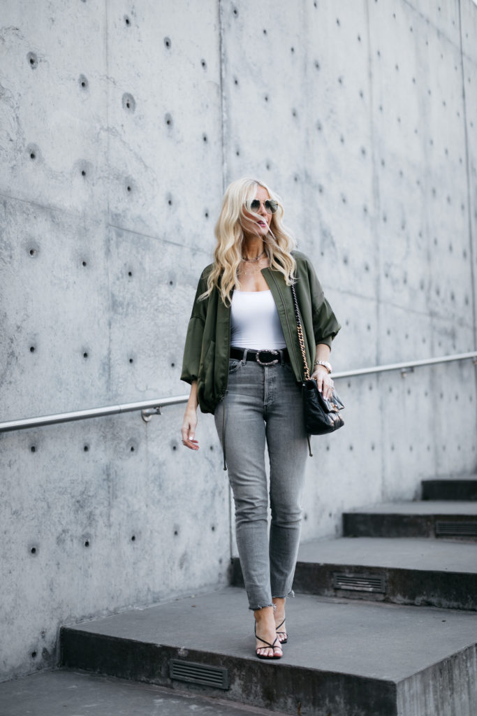 Dallas fashion blogger wearing grey jeans and a jacket