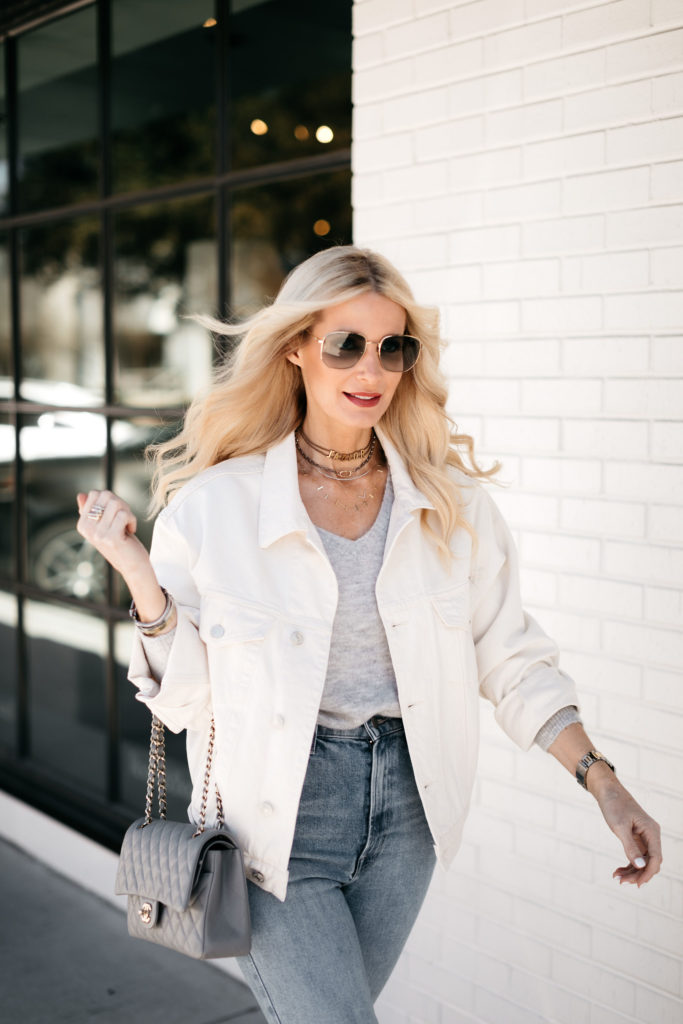 Dallas blogger wearing a white jean jacket and a grey tee