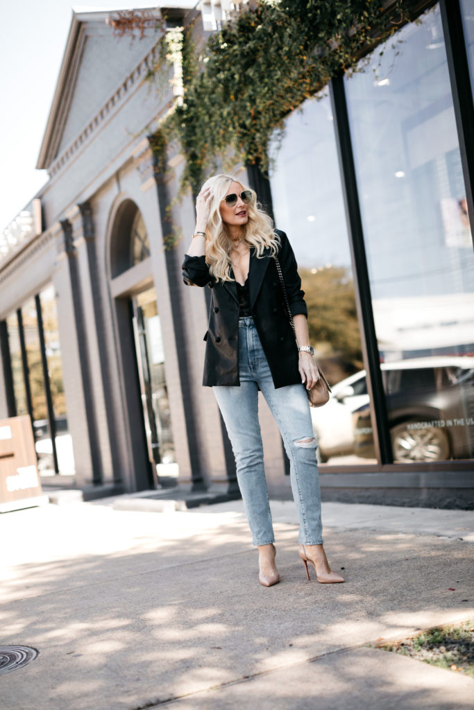 Dallas influencer wearing a black blazer and denim