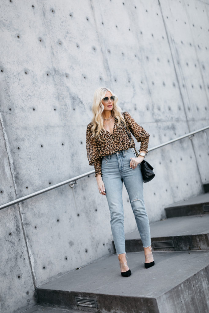 Dallas influencer wearing a leopard top and jeans