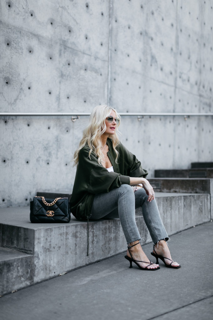 Dallas blogger wearing denim and a spring jacket