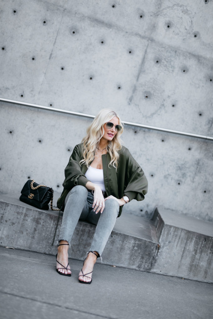 Fashion blogger wearing a jacket and black heels