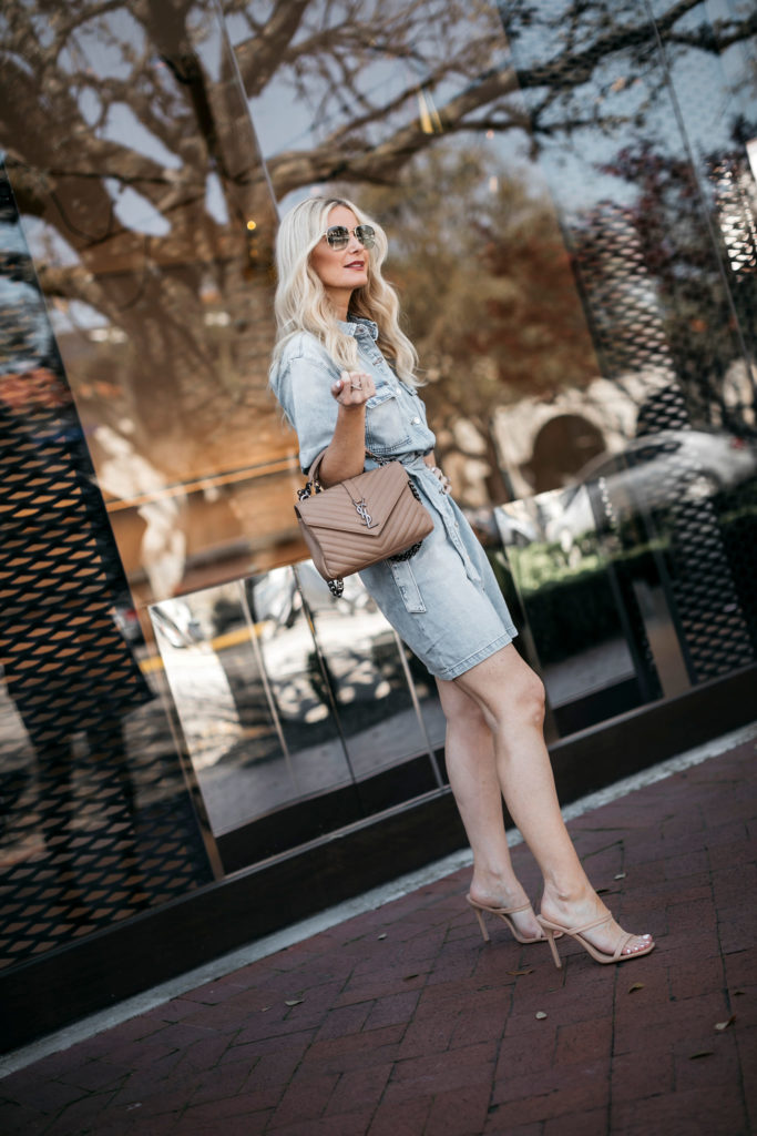 Dallas style blogger wearing a denim dress and a designer handbag