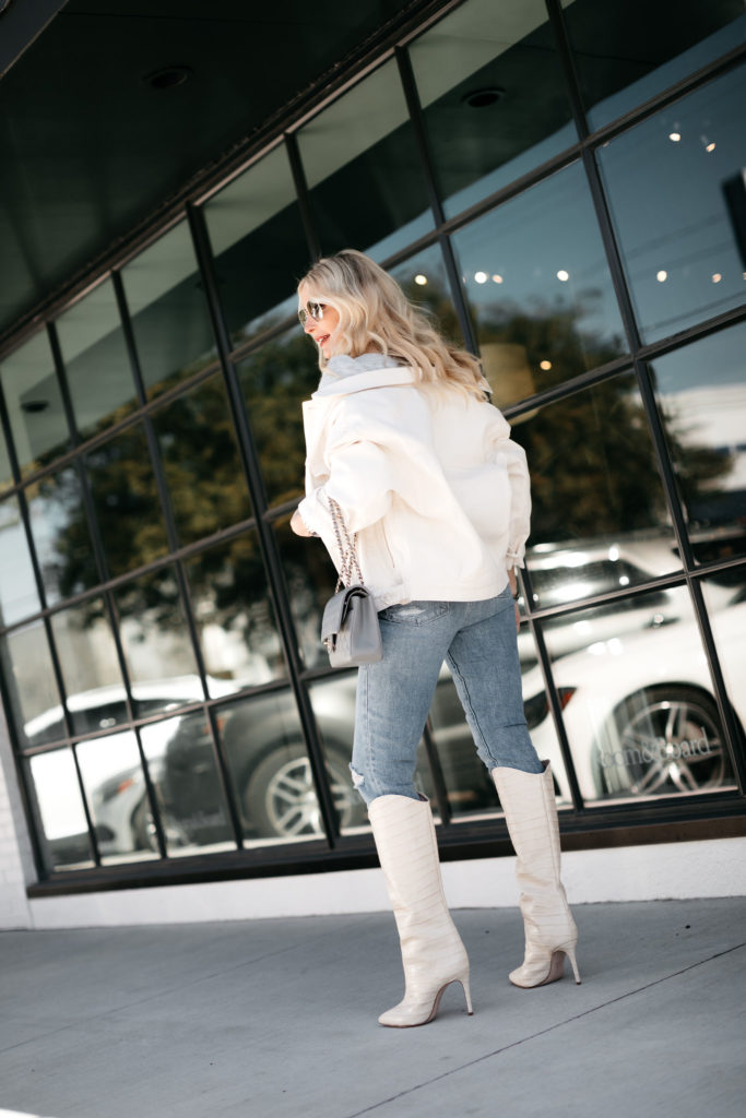 Style blogger wearing a white jacket with denim