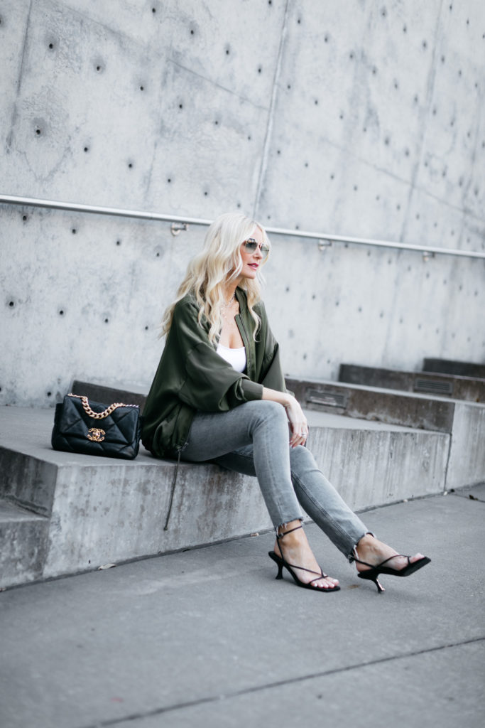 Dallas fashion blogger wearing a lightweight jacket and jeans