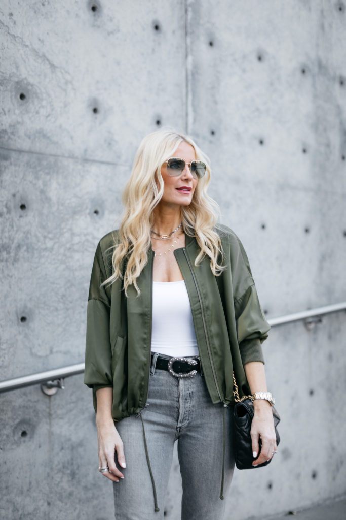 Fashion blogger wearing an army green jacket and a belt