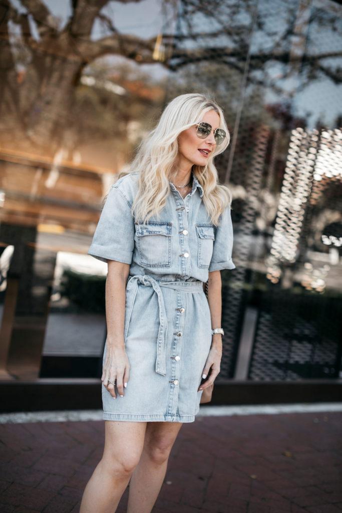 Fashion blogger wearing a denim dress and sunglasses