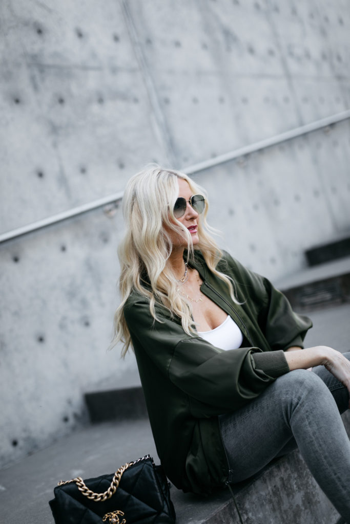 Dallas style blogger wearing Gucci sunglasses and a dark green jacket