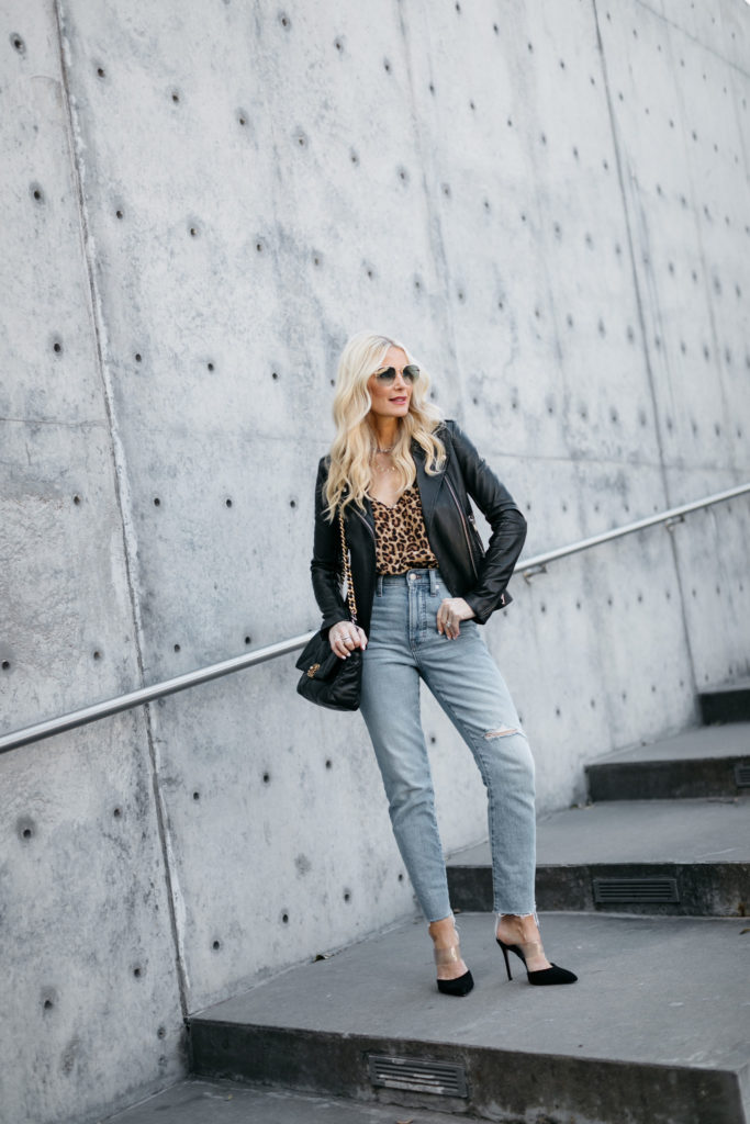 Dallas blogger wearing a leather jacket and jeans