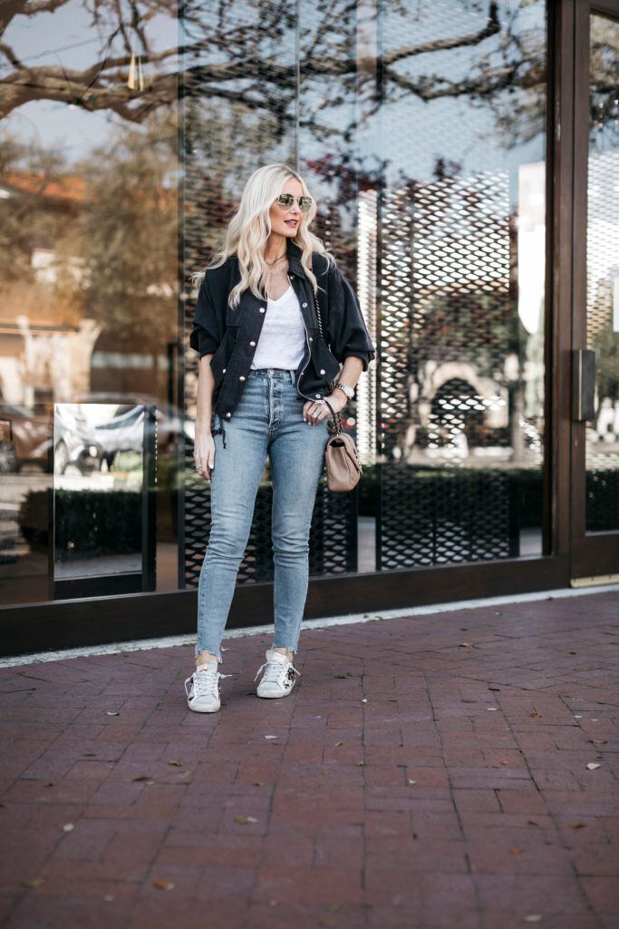 Fashion blogger wearing a white tee and light wash denim