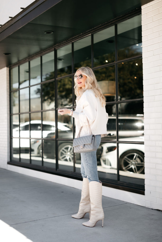Dallas style blogger wearing denim and white knee-high boots